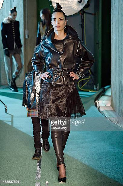 A model walks the runway at the Jean Paul Gaultier Autumn Winter 2014 fashion show during Paris Fashion Week on March 1 2014 in Paris France