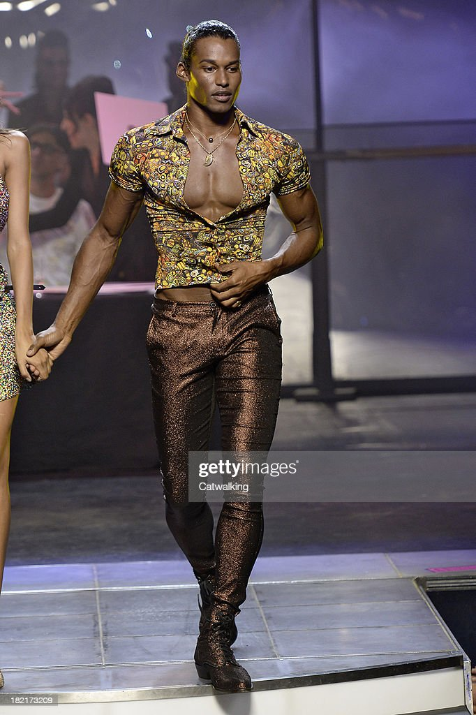 A model walks the runway at the Jean Paul Gaultier Spring Summer 2014 fashion show during Paris Fashion Week on September 28, 2013 in Paris, France.