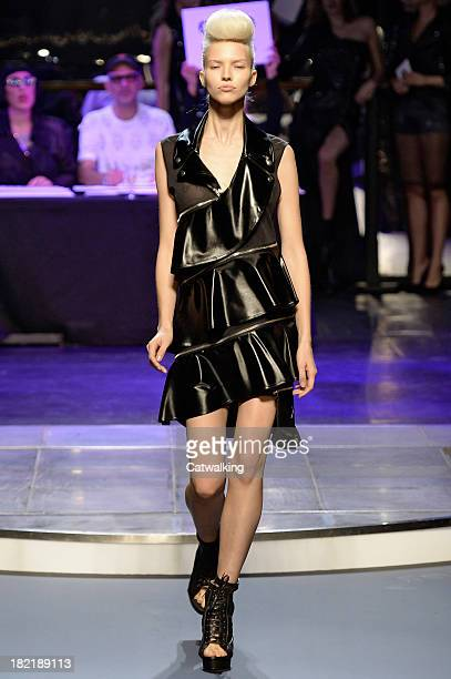 A model walks the runway at the Jean Paul Gaultier Spring Summer 2014 fashion show during Paris Fashion Week on September 28 2013 in Paris France