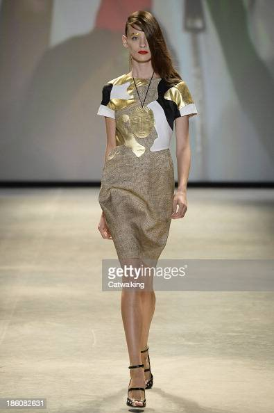 A model walks the runway at the JeanCharles De Castelbajac Spring Summer 2014 fashion show during Paris Fashion Week on October 1 2013 in Paris France
