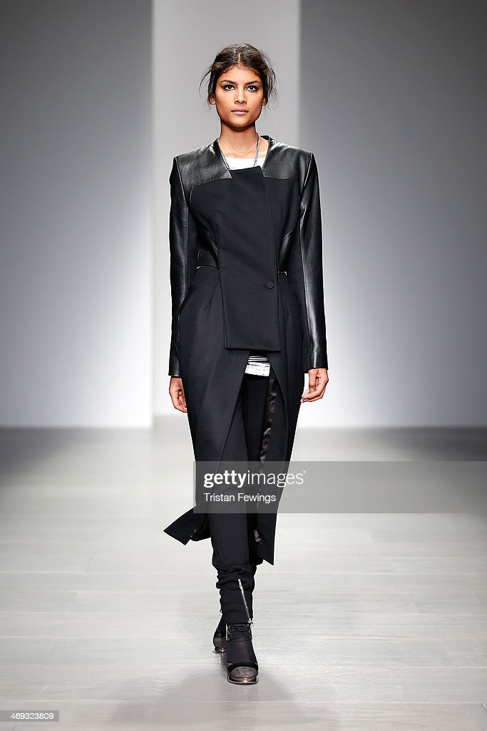 A model walks the runway at the Jean-Pierre Braganza show at London Fashion Week AW14 at Somerset House on February 14, 2014 in London, England.