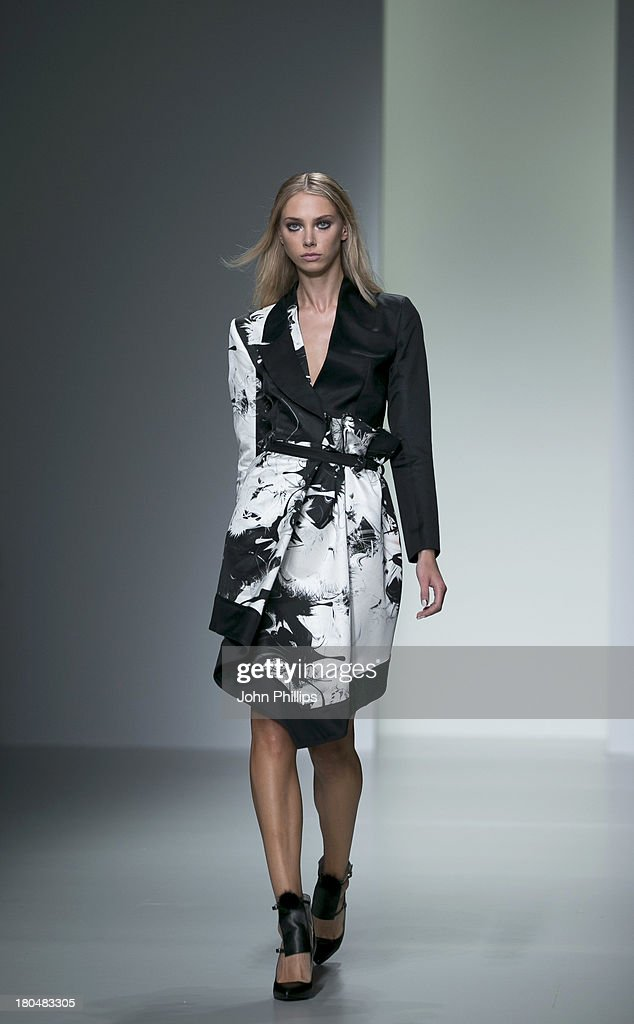 A model walks the runway at the Jean-Pierre Braganza show during London Fashion Week SS14 at BFC Courtyard Showspace on September 13, 2013 in London, England.