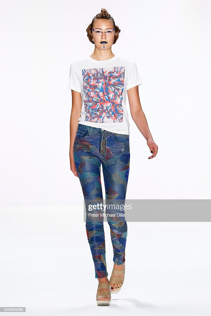 A model walks the runway at the Jeans For Refugees By Johny Dar show during the Mercedes-Benz Fashion Week Berlin Spring/Summer 2017 at Erika Hess Eisstadion on July 1, 2016 in Berlin, Germany.