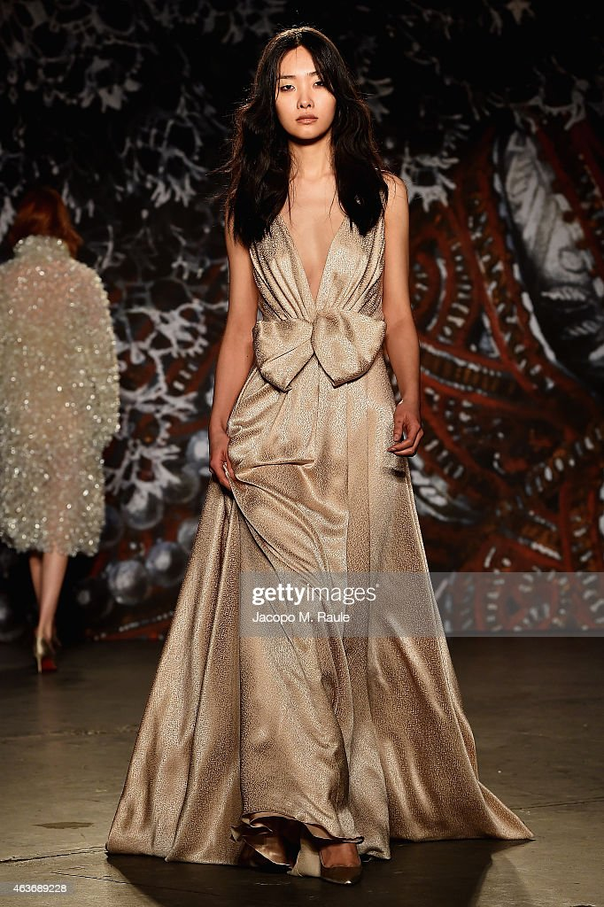 A model walks the runway at the Jenny Packham fashion show during MercedesBenz Fashion Week Fall 2015 at Industria Studios on February 17 2015 in New...