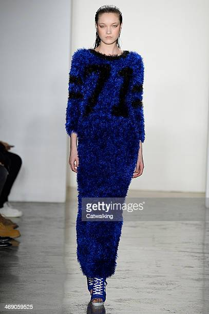 A model walks the runway at the Jeremy Scott Autumn Winter 2014 fashion show during New York Fashion Week on February 12 2014 in New York United...