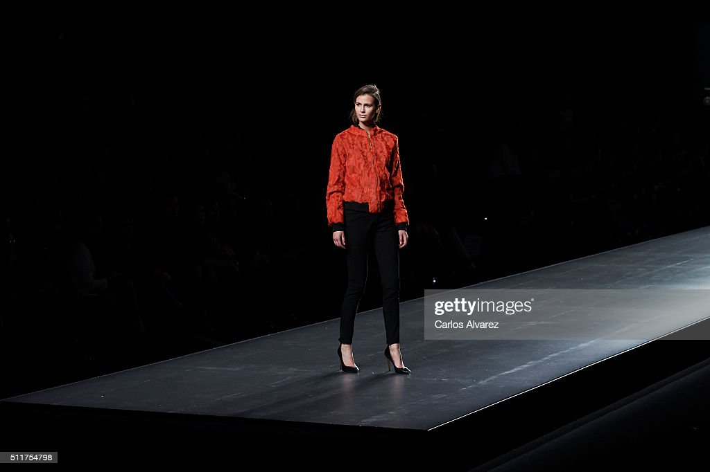 A model walks the runway at the Jesus Lorenzo show during the MercedesBenz Madrid Fashion Week Autumn/Winter 2016/2017 at Ifema on February 22 2016...