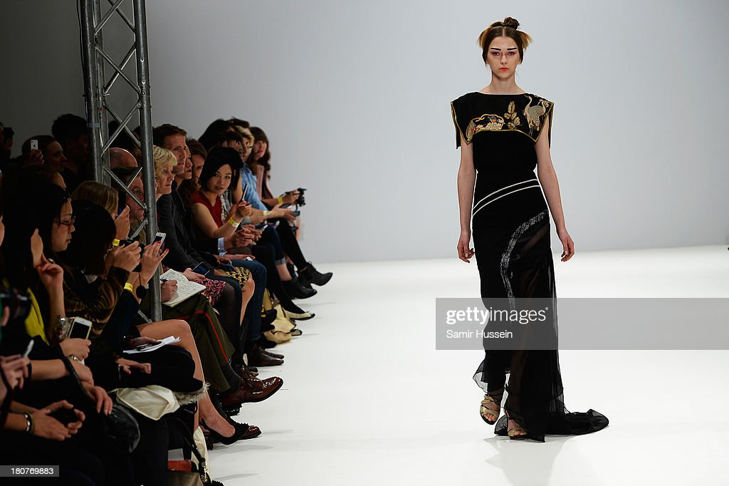 A model walks the runway at the Ji Cheng Sheme show during at the Fashion Scout venue during London Fashion Week SS14 at Freemasons Hall on September 16, 2013 in London, England.