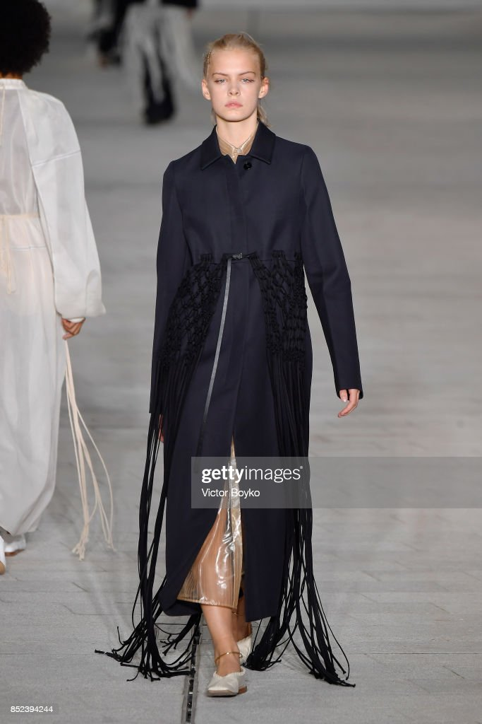 model-walks-the-runway-at-the-jil-sander-show-during-milan-fashion-picture-id852394244