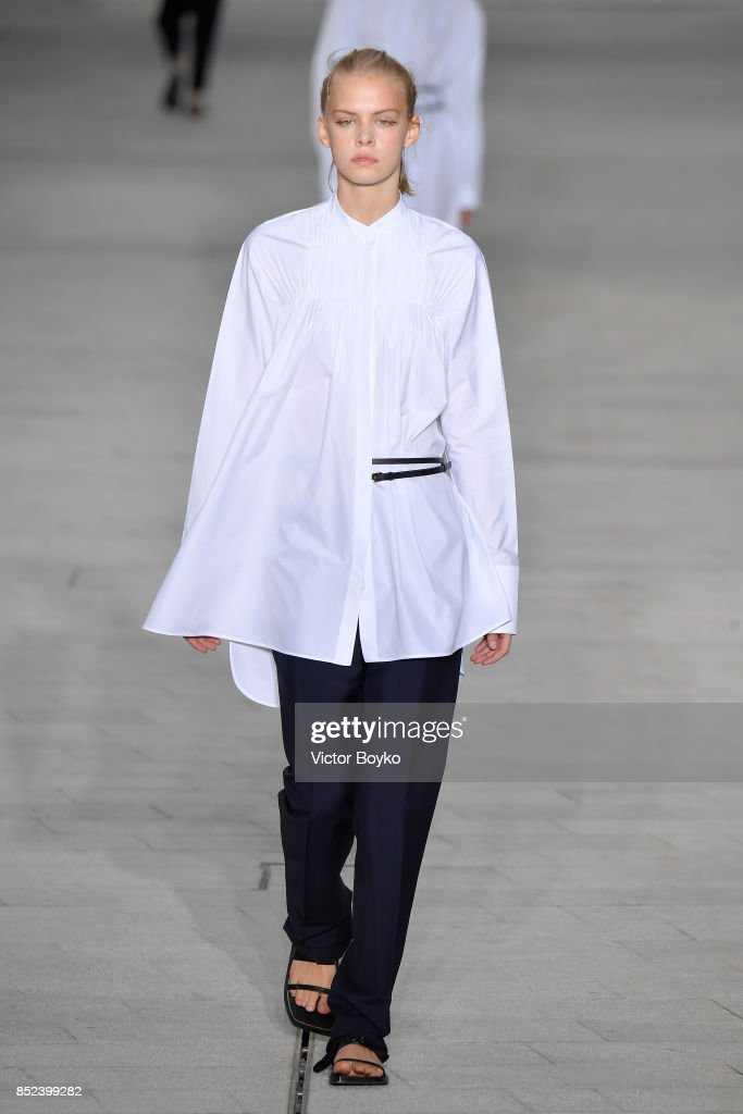 model-walks-the-runway-at-the-jil-sander-show-during-milan-fashion-picture-id852399282