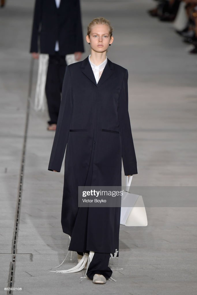 model-walks-the-runway-at-the-jil-sander-show-during-milan-fashion-picture-id852402106