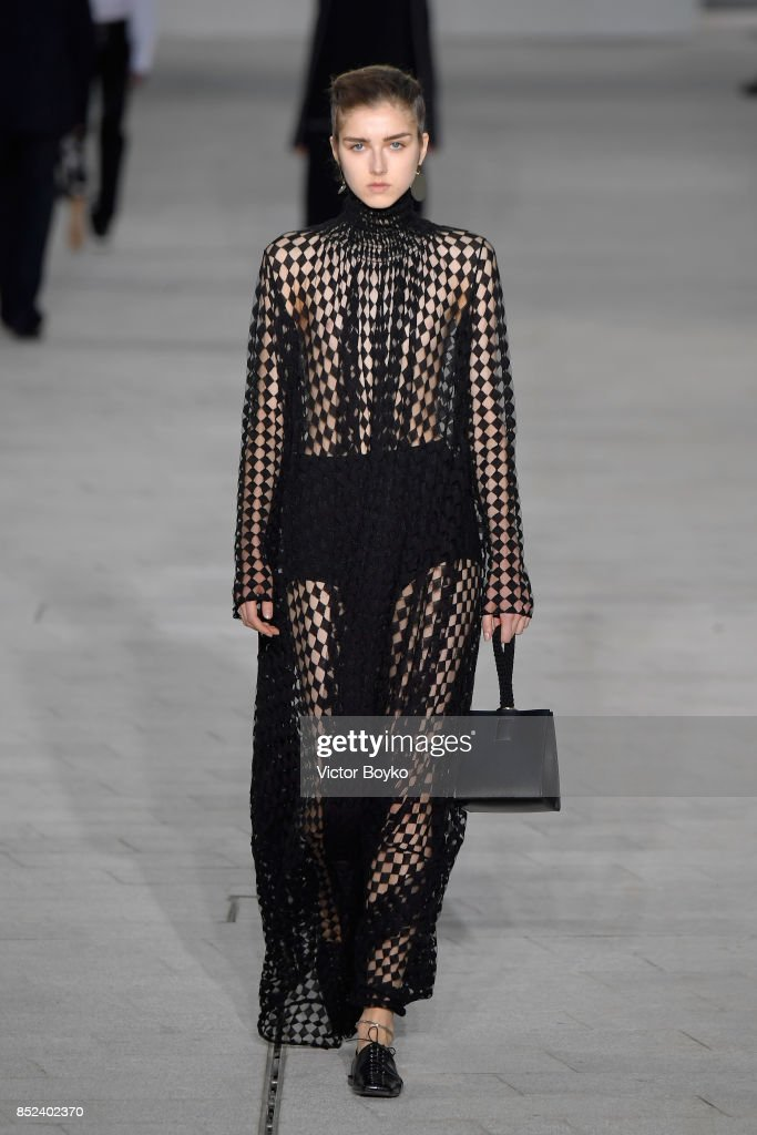 model-walks-the-runway-at-the-jil-sander-show-during-milan-fashion-picture-id852402370