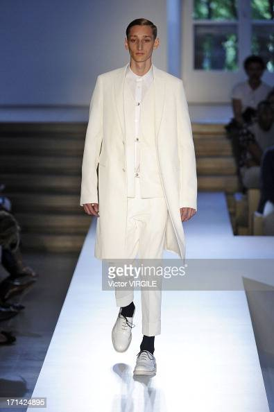 A model walks the runway at the Jil Sander show during Milan Menswear Fashion Week Spring Summer 2014 on June 22 2013 in Milan Italy