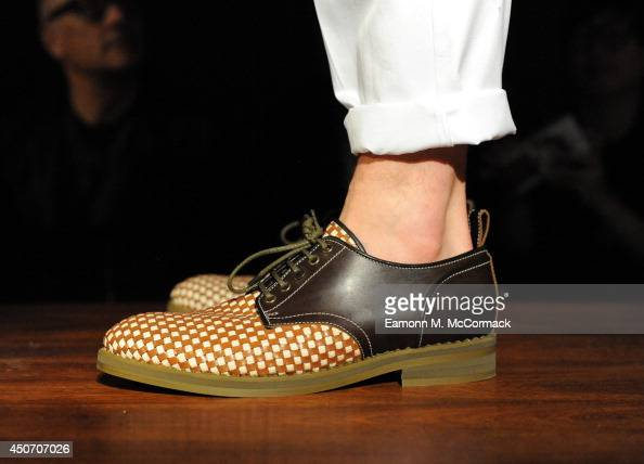 A model walks the runway at the Jimmy Choo show during the London Collections Men SS15 on June 16 2014 in London England