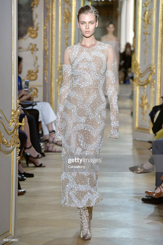A model walks the runway at the JMendel Autumn Winter 2016 fashion show during Paris Haute Couture Fashion Week on July 5 2016 in Paris France