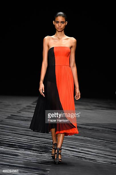 A model walks the runway at the JMendel fashion show during MercedesBenz Fashion Week Spring 2015 at The Theatre at Lincoln Center on September 11...