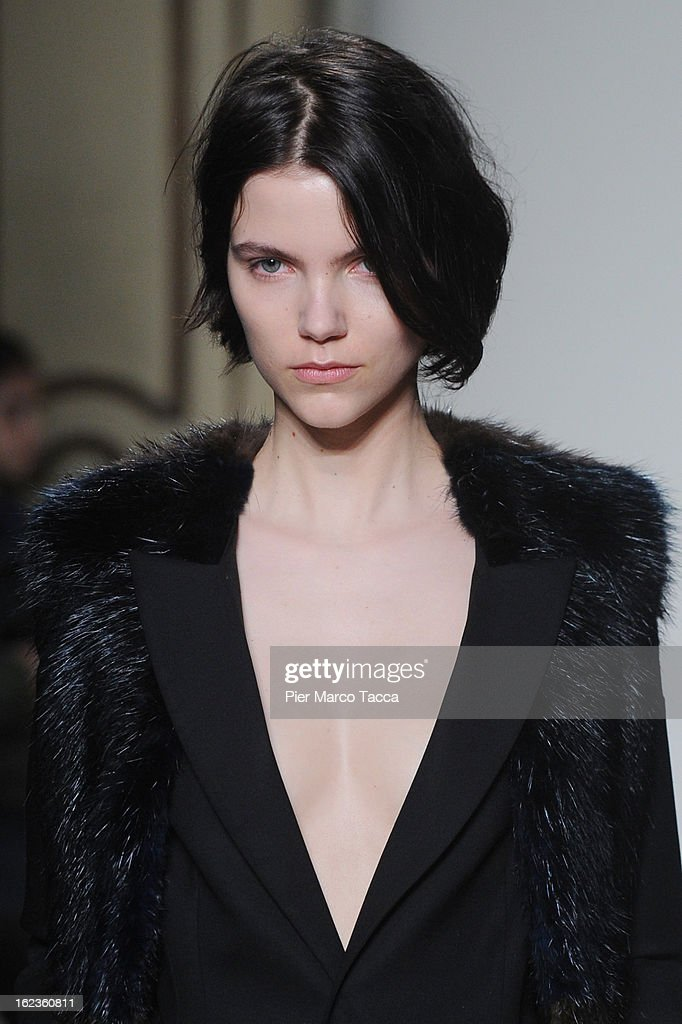 A model walks the runway at the Jo No Fui fashion show during Milan Fashion Week Womenswear Fall/Winter 2013/14 on February 22, 2013 in Milan, Italy.