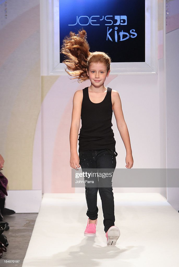 A model walks the runway at the Joe's Kids show during the Swarovski Elements at Petite Parade NY Kids Fashion Week In Collaboration With VOGUEbambini - Day 2 at Industria Superstudio on October 21, 2012 in New York City.