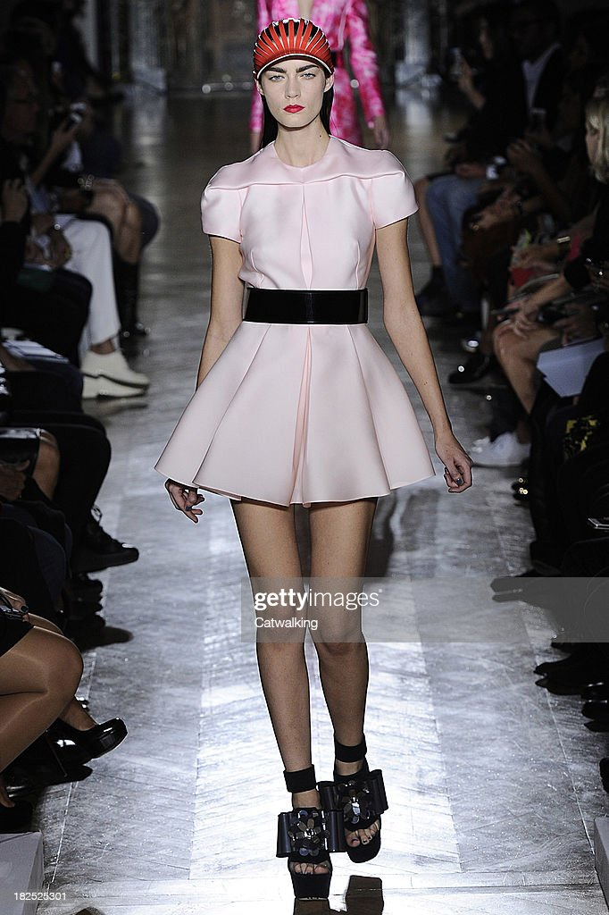 A model walks the runway at the John Galliano Spring Summer 2014 fashion show during Paris Fashion Week on September 29, 2013 in Paris, France.