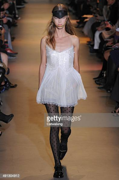 A model walks the runway at the John Galliano Spring Summer 2016 fashion show during Paris Fashion Week on October 4 2015 in Paris France