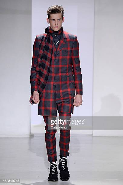 A model walks the runway at the John Lawrence Sullivan Autumn Winter 2014 fashion show during Paris Menswear Fashion Week on January 15 2014 in Paris...