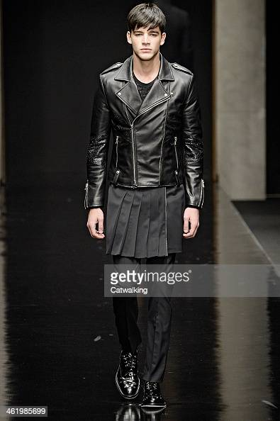 A model walks the runway at the John Richmond Autumn Winter 2014 fashion show during Milan Menswear Fashion Week on January 12 2014 in Milan Italy