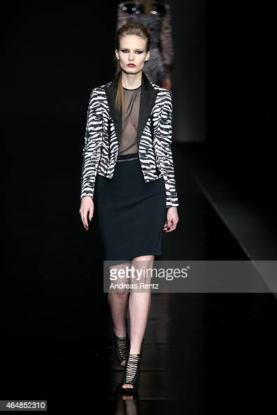 A model walks the runway at the John Richmond show during the Milan Fashion Week Autumn/Winter 2015 on March 1 2015 in Milan Italy