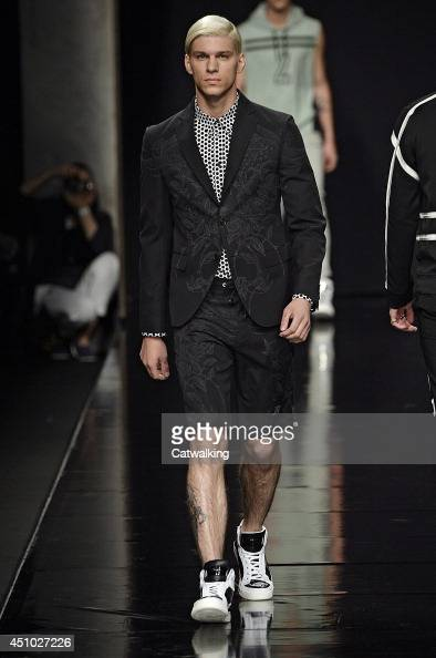 A model walks the runway at the John Richmond Spring Summer 2015 fashion show during Milan Menswear Fashion Week on June 22 2014 in Milan Italy