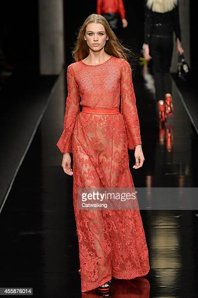 A model walks the runway at the John Richmond Spring Summer 2015 fashion show during Milan Fashion Week on September 21 2014 in Milan Italy