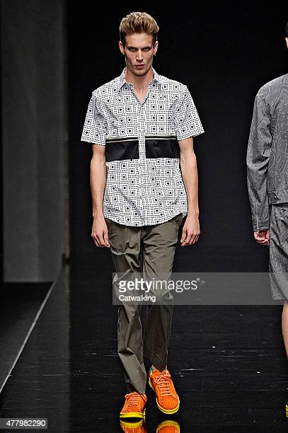 A model walks the runway at the John Richmond Spring Summer 2016 fashion show during Milan Menswear Fashion Week on June 21 2015 in Milan Italy