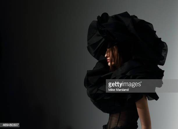 A model walks the runway at the John Rocha show at London Fashion Week AW14 at Somerset House on February 15 2014 in London England