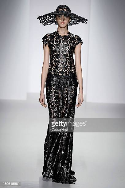 A model walks the runway at the John Rocha Spring Summer 2014 fashion show during London Fashion Week on September 14 2013 in London United Kingdom