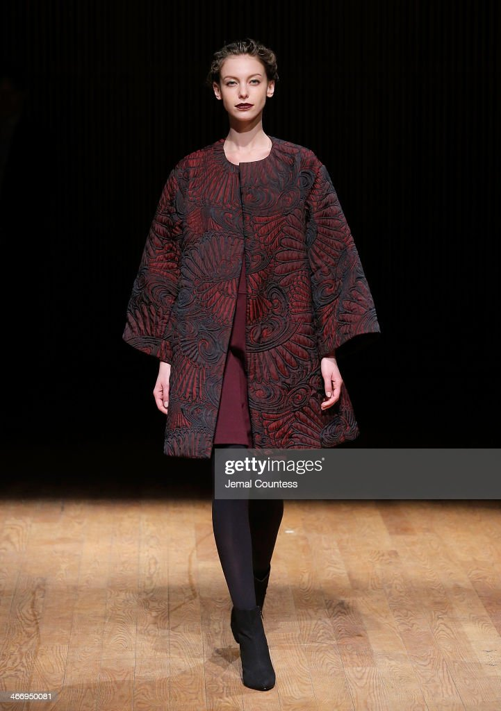A model walks the runway at the Josie Natori Fall 2014 fashion show at Dimenna Center for Classical Music on February 5, 2014 in New York City.