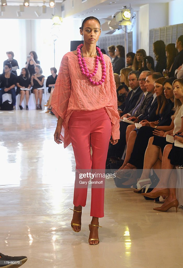 A model walks the runway at the Josie Natori fashion show during Spring 2014 Mercedes-Benz Fashion Week at 180 Madison Avenue on September 4, 2013 in New York City.