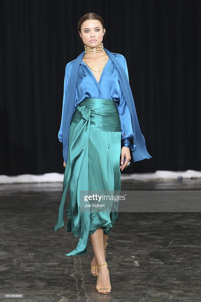A model walks the runway at the Juan Carlos Obando during Mercedes Benz Fashion Week Spring 2014 at Industria Superstudio on September 12, 2013 in New York City.