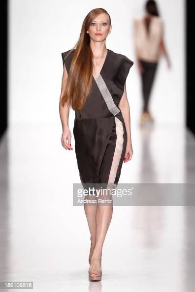 A model walks the runway at the Julia Dalakian show during MercedesBenz Fashion Week Russia S/S 2014 on October 28 2013 in Moscow Russia