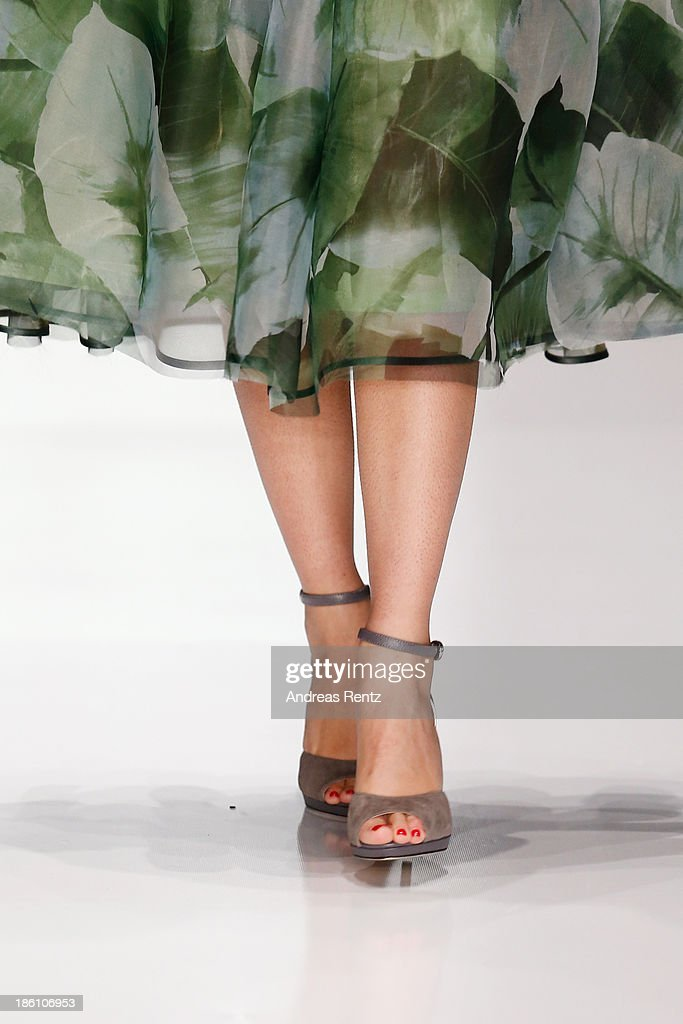 A model walks the runway (detail) at the Julia Dalakian show during Mercedes-Benz Fashion Week Russia S/S 2014 on October 28, 2013 in Moscow, Russia.