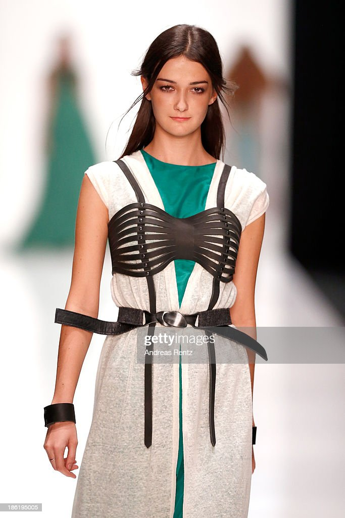 A model walks the runway at the Julia Kupinskaya show during Mercedes-Benz Fashion Week Russia S/S 2014 on October 29, 2013 in Moscow, Russia.