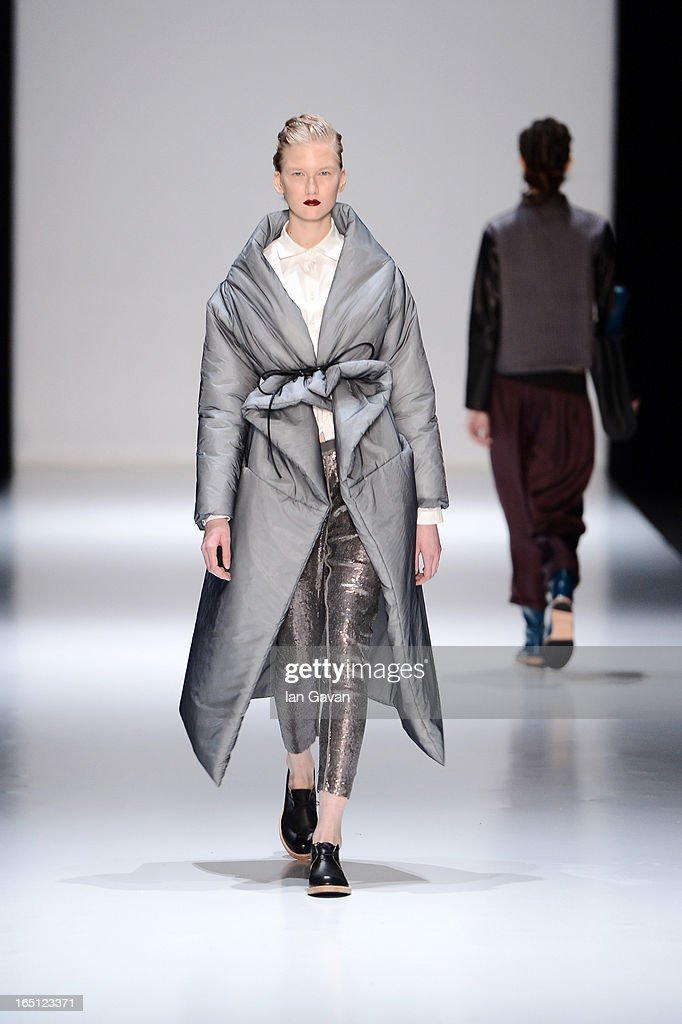 A model walks the runway at the Julia Nikolaeva show during Mercedes-Benz Fashion Week Russia Fall/Winter 2013/2014 at Manege on March 31, 2013 in Moscow, Russia.