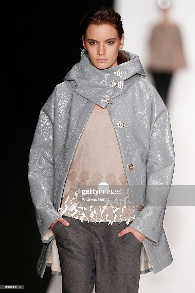 A model walks the runway at the Julia Nikolaeva show during Mercedes-Benz Fashion Week Russia S/S 2014 on October 27, 2013 in Moscow, Russia.