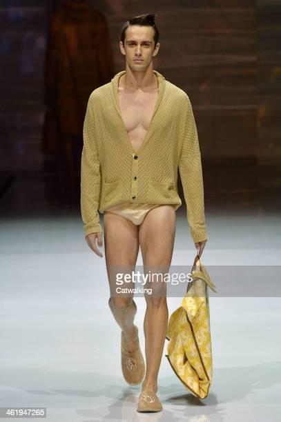 A model walks the runway at the Julian Zigerli Autumn Winter 2014 fashion show during Milan Menswear Fashion Week on January 11 2014 in Milan Italy