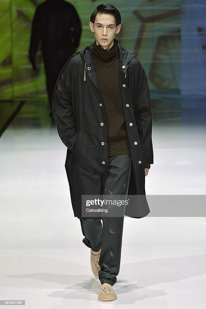 A model walks the runway at the Julian Zigerli Autumn Winter 2014 fashion show during Milan Menswear Fashion Week on January 11, 2014 in Milan, Italy.