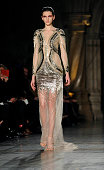 A model walks the runway at the Julien Macdonald show at London Fashion Week AW14 at Royal Courts of Justice Strand on February 15 2014 in London...