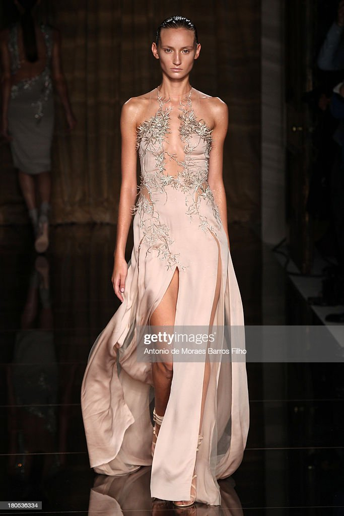 A model walks the runway at the Julien Macdonald show during London Fashion Week SS14 on September 14, 2013 in London, England.