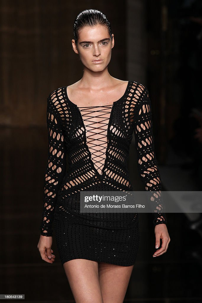 A model walks the runway at the Julien Macdonald show during London Fashion Week SS14 at on September 14, 2013 in London, England.