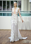 A model walks the runway at the Julien Macdonald show during London Fashion Week Spring Summer 2015 at the Royal Opera House on September 13 2014 in...