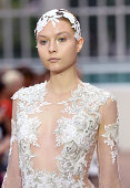 A model walks the runway at the Julien Macdonald show during London Fashion Week Spring Summer 2015 at on September 13 2014 in London England