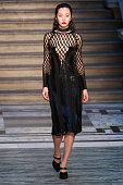 A model walks the runway at the Julien Macdonald show during London Fashion Week Fall/Winter 2015/16 at The Banking Hall on February 21 2015 in...