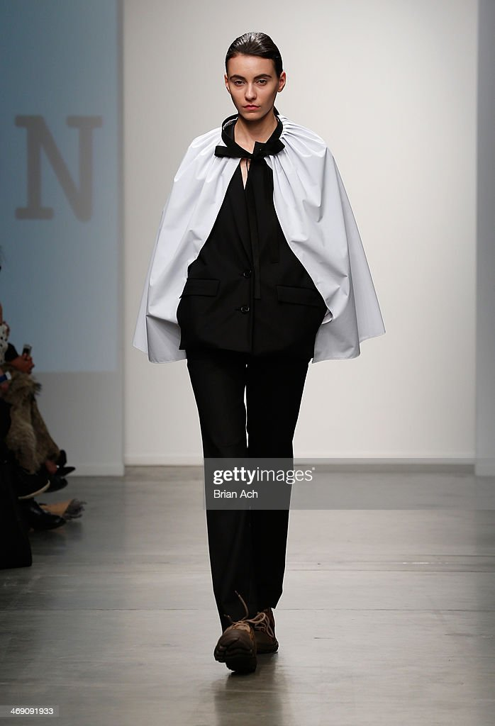 A model walks the runway at the Jungwon show during Nolcha Fashion Week New York Fall/Winter 2014 at Pier 59 on February 12, 2014 in New York City.