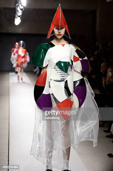 A model walks the runway at the Junya Watanabe Spring Summer 2015 fashion show during Paris Fashion Week on September 27 2014 in Paris France