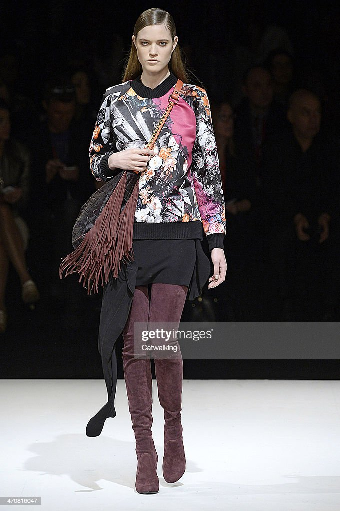 A model walks the runway at the Just Cavalli Autumn Winter 2014 fashion show during Milan Fashion Week on February 20, 2014 in Milan, Italy.